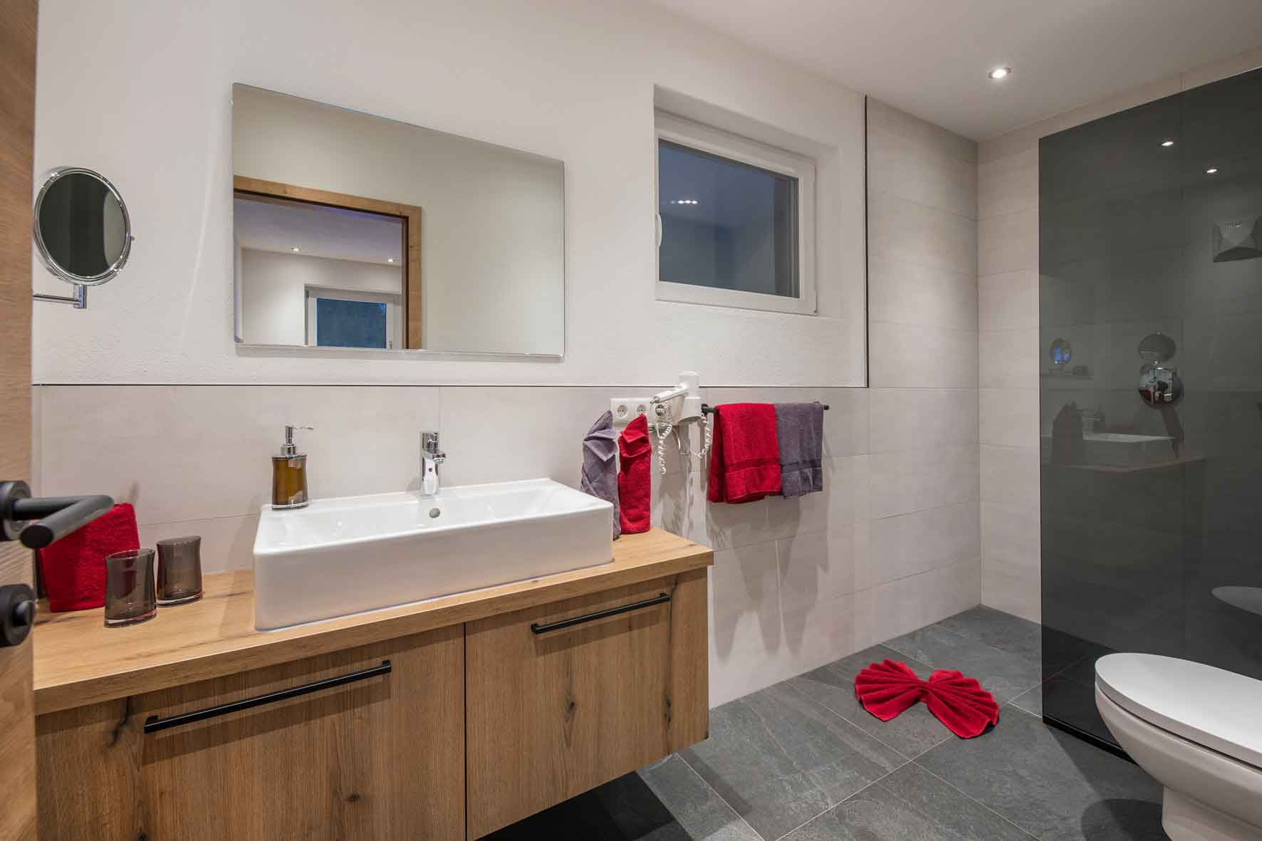 first class sanitary facility with walk-in shower and WC